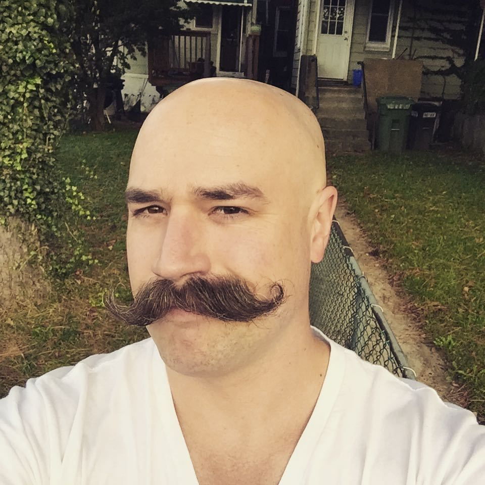french man with mustache